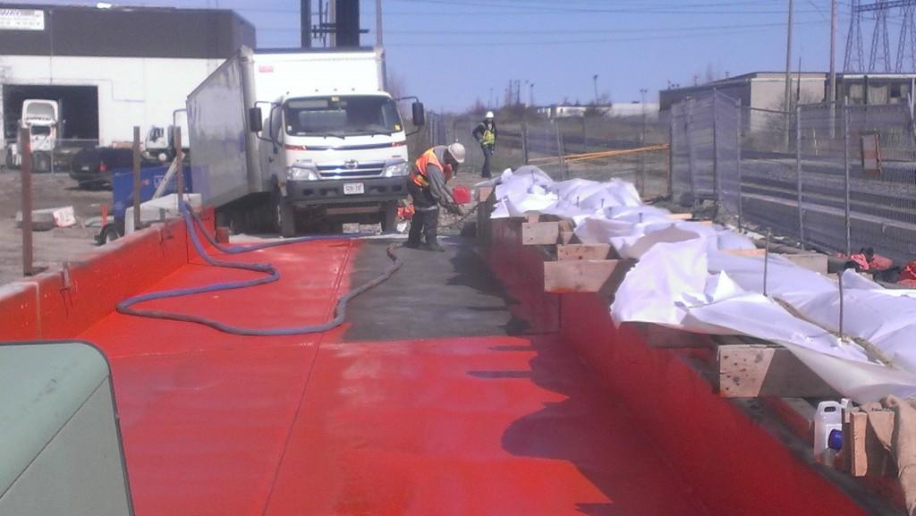 Spray applied waterproofing membrane on concrete bridge