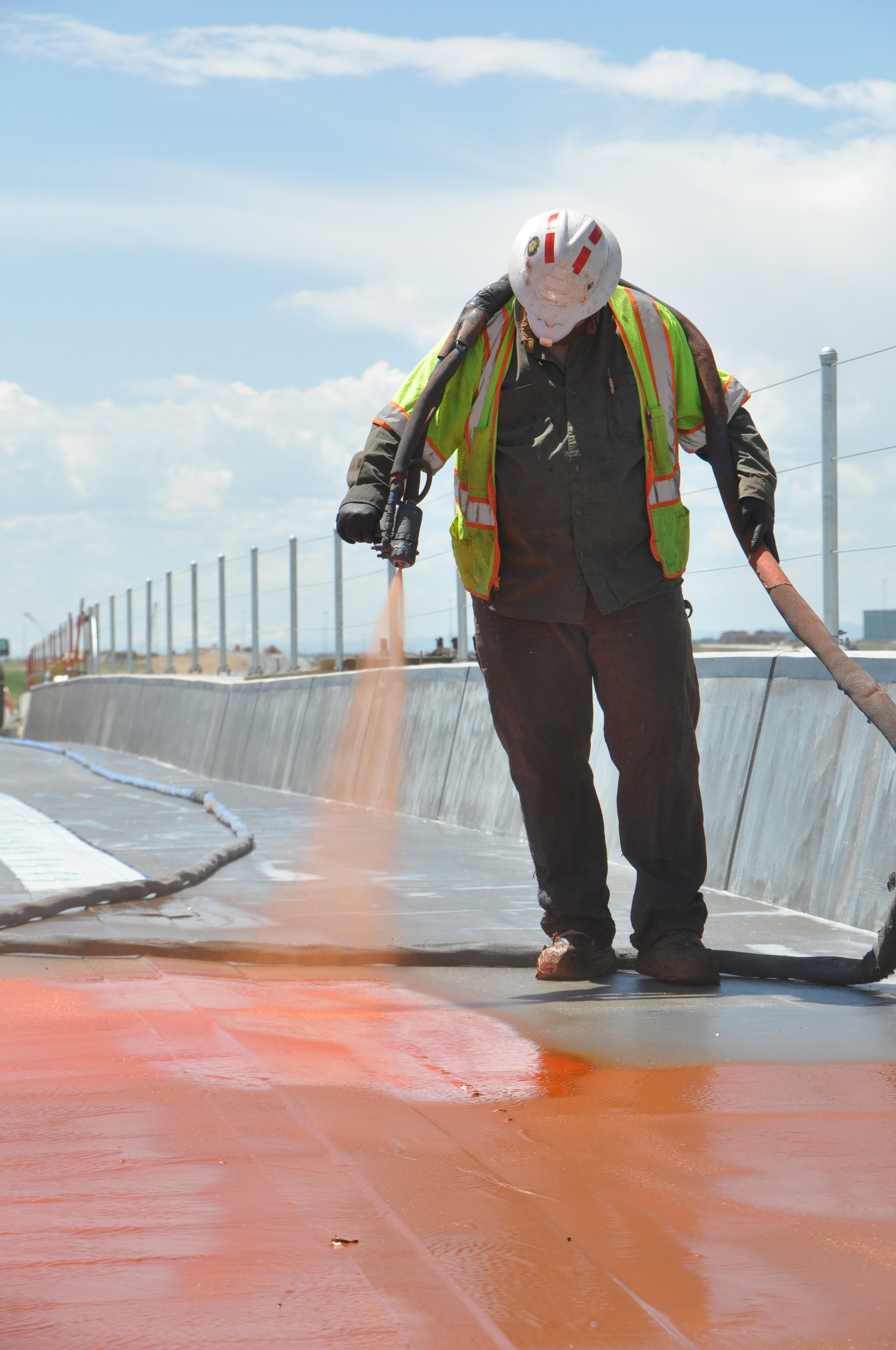 A worker installs BDM™ on the Eagle P3 56th Ave. Bridge