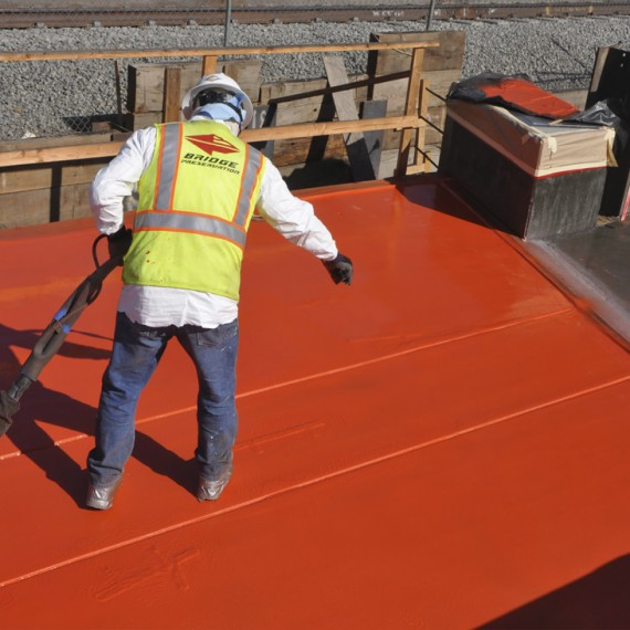 high performance spray applied ballast mat
